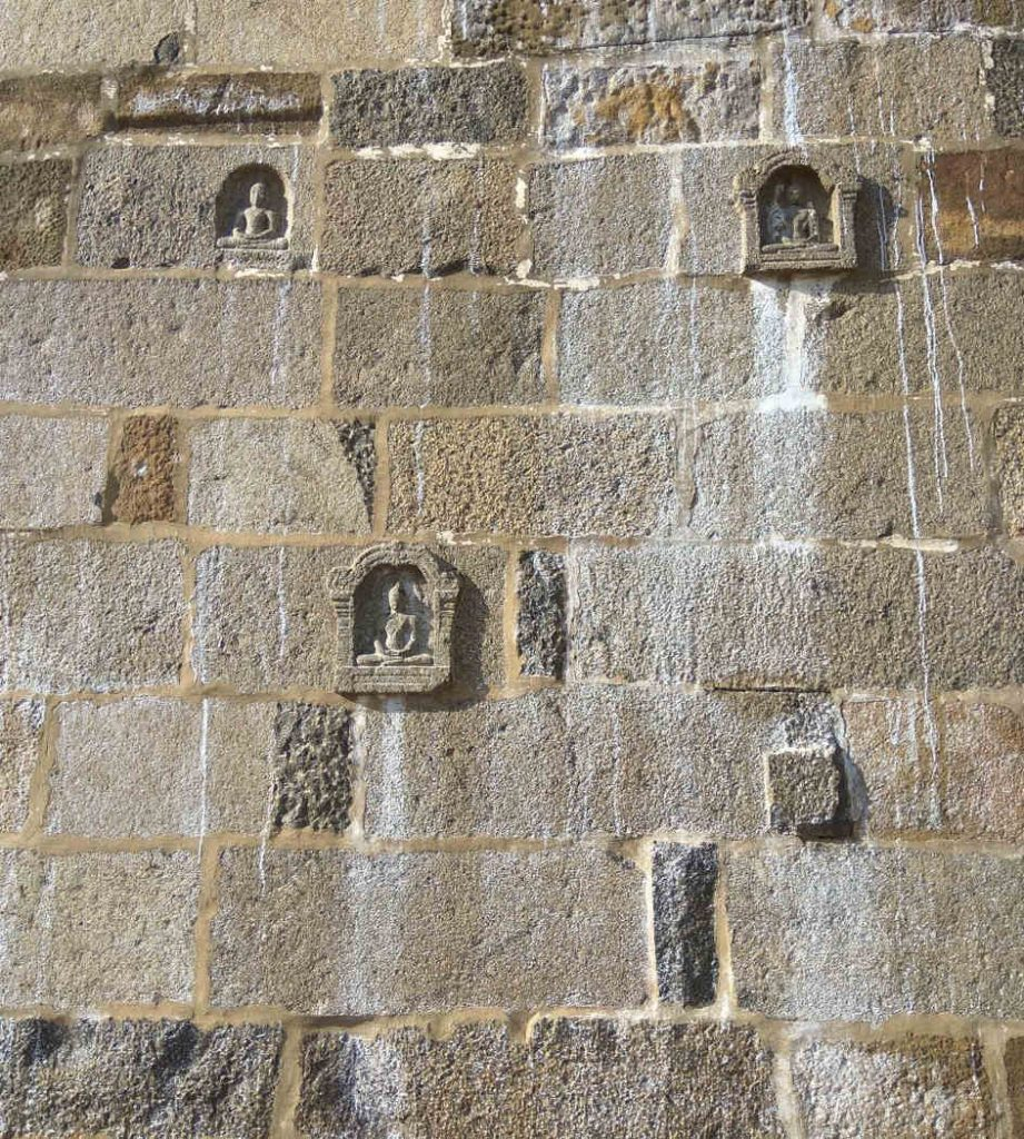 Buddha images in the compound wall of Ekambareswarar Temple, Kanchi.