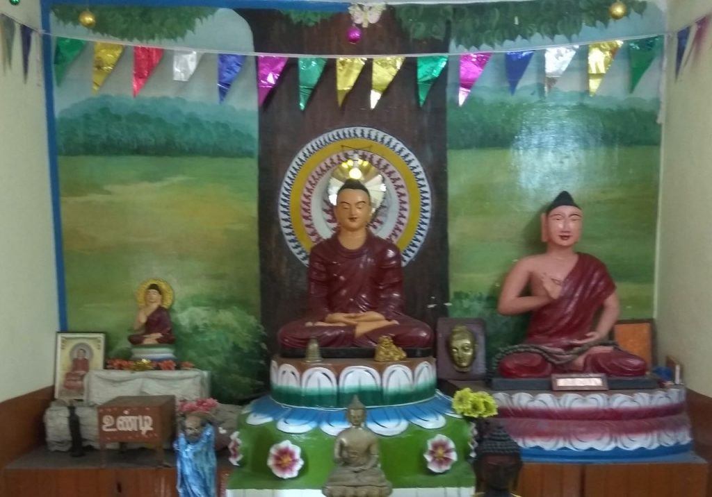 An ancient Buddha head (the right most with a new body) preserved in a new Dhamma centre at Konerikuppam, Kanchi.