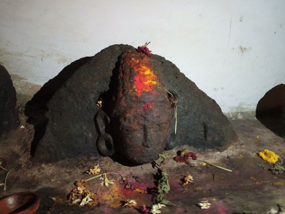A Bodhisattva idol partly buried in the new concrete base inside the Kallesvara cave in Kalya, Magadi near Bangalore.
